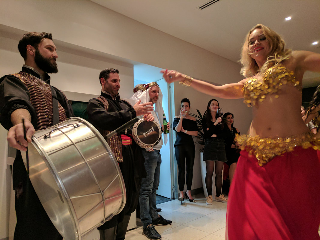 Hire a Belly dancer and drummer