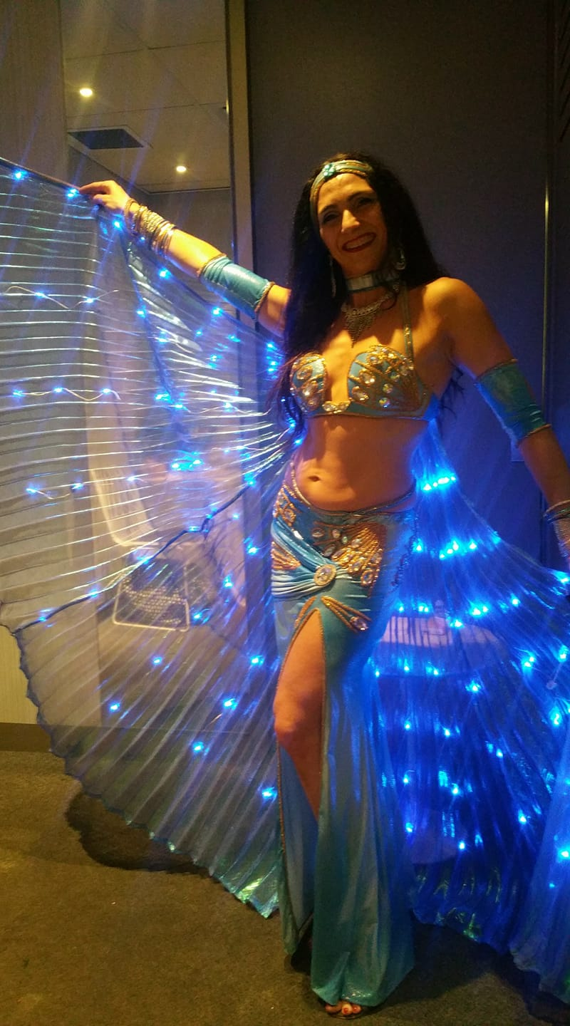 Hire a Bellydancer with beautiful LED wings for your next event!