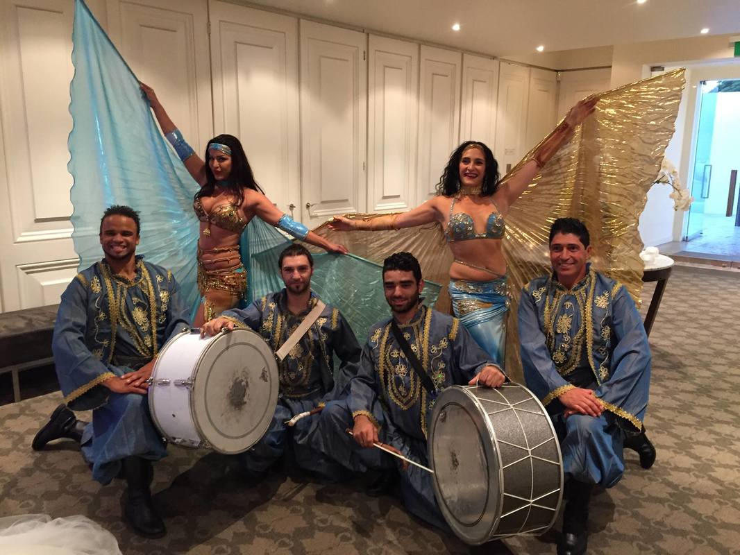Drumming show with wings at a wedding