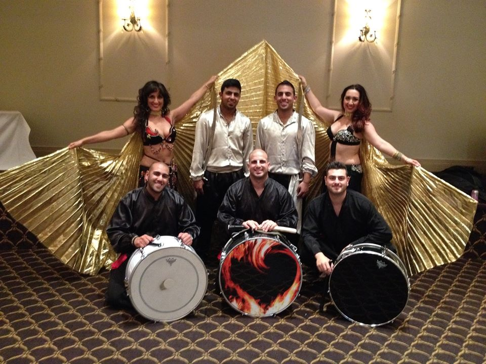 Gold winged belly dance performance with live drummers